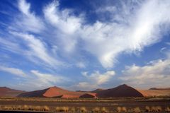 Sossusvlei Dune National park. Sossusvlei on a sunny blue sky day where the red iron oxide dunes are static stock photo