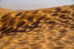 Sossusvlei dunes at Dead Vlei. Patterns, shadows and light orange dunes royalty free stock photography