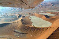 Sossusvlei: Flying over the Namib Desert. Namib Desert aerial view. Picture taken from a mini airplane Royalty Free Stock Photography