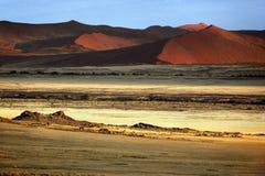 Sossusvlei - Namib Desert - Namibia. Early morning sunshine on the sand dunes at Sossusvlei in the Namib-Nuakluft Desert in Namibia royalty free stock images