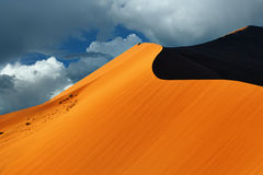 Sossusvlei, Namib Naukluft National Park, Namibia. Beautiful landscape with big red dune 40 against dramatic sky at sunrise, Sossusvlei, Namib Naukluft National Stock Photos