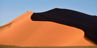 Sossusvlei, Namib Naukluft National Park, Namibia. Beautiful landscape with big red dune 40 at sunrise, Sossusvlei, Namib Naukluft National Park, Namibia Royalty Free Stock Photos