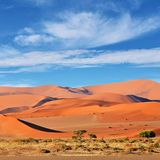Sossusvlei, Namib Naukluft National Park, Namibia. Beautiful landscape with big red dunes and cloudy sky at sunrise, Sossusvlei, Namib Naukluft National Park Stock Image