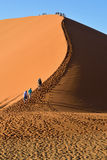 SOSSUSVLEI, NAMIBIA, DUNE 45. SOSSUSVLEI, NAMIBIA - JAN 29, 2016: Tourists climb Dune No.45 most popular dune in the whole World, Namibia, Africa royalty free stock image