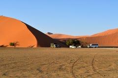 SOSSUSVLEI, NAMIBIA, DUNE 45. SOSSUSVLEI, NAMIBIA - JAN 29, 2016: Tourists climb Dune No.45 at sunrise, most popular dune in the whole World, Namibia, Africa Stock Image