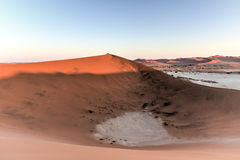 Sossusvlei, Namibia. Sossusvlei (sometimes written Sossus Vlei) is a salt and clay pan surrounded by high red dunes, located in the southern part of the Namib Stock Images