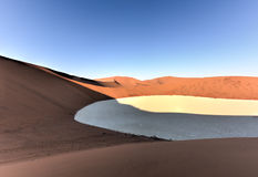 Sossusvlei, Namibia. Sossusvlei (sometimes written Sossus Vlei) is a salt and clay pan surrounded by high red dunes, located in the southern part of the Namib Stock Image