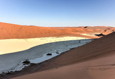 Sossusvlei, Namibia. Sossusvlei (sometimes written Sossus Vlei) is a salt and clay pan surrounded by high red dunes, located in the southern part of the Namib Stock Photos