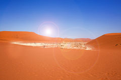 Sossusvlei pan in Namib Naukluft with Orange Dunes and a bright blue sky Stock Images