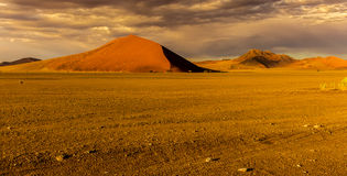 Sossusvlie Sand Dunes, Namib Desert. Image taken shortly after dawn... Sossusvlei is a salt and clay pan surrounded by high red dunes, located in the southern Royalty Free Stock Photography