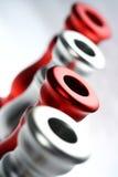 Sostenedores rojos y de plata I Foto de archivo libre de regalías
