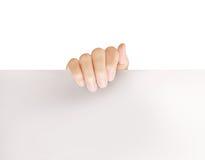 Sostener el papel blanco del espacio en blanco A4 Imagen de archivo