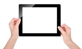 Sostener la pantalla en blanco de la tableta en blanco foto de archivo