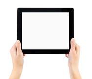 Sostener la PC electrónica de la tablilla en manos Foto de archivo