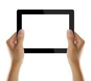Sostener la PC electrónica de la tablilla en manos Fotografía de archivo libre de regalías
