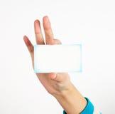 Sostener la tarjeta Foto de archivo libre de regalías