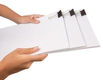 Sostener los clips y el Libro Blanco II de la carpeta Imagen de archivo