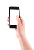 Sostener smartphone móvil con la pantalla en blanco Foto de archivo libre de regalías