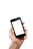 Sostener smartphone móvil con la pantalla en blanco Fotos de archivo libres de regalías