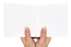 Sostener un libro vacío Imagen de archivo libre de regalías
