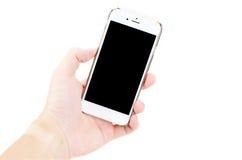 Sostenga la célula o el teléfono móvil Fotos de archivo libres de regalías