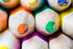 Sostenidos de lápices coloreados afilados Fotografía de archivo libre de regalías