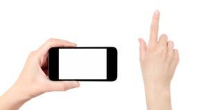 Sosteniendo el teléfono móvil con la mano conmovedora aislado