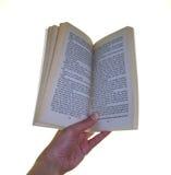 Sosteniendo un libro ábrase Imagen de archivo libre de regalías
