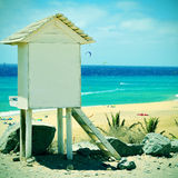 Sotavento Beach in Fuerteventura, Canary Islands, Spain. Picture of a lifeguard tower in Sotavento Beach in Fuerteventura, Canary Islands, Spain, with a retro royalty free stock images