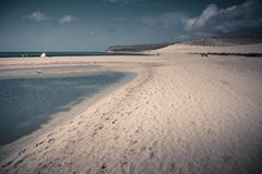 Sotavento Beach with sand tongue crossing the water. Picture taken in Sotavento beach, Fuerteventura, featuring shallow blue water and a sand tongue in the Royalty Free Stock Photos
