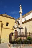 Soterrano church, Aguilar de la Frontera. Soterrano church with a monument in the foreground (Iglesia de Soterrano), Aguilar de la Frontera, Cordoba Province Royalty Free Stock Image