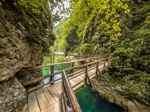 Soteska vintgar gorge bridge boardwalk on sunny day. Soteska vintgar gorge with bridge in boardwalk along river on sunny day Royalty Free Stock Images