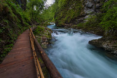 Soteska Vintgar in the river Radovna. Magical canyon with waterfalls and wooden bridge in Slovenia mountains Stock Photography