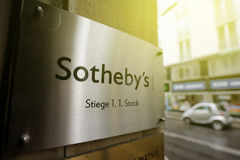 Sotheby`s logo ner Office on sunny day Stock Photos