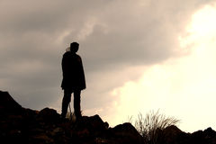 Sothu young man in the mountains. Silhouette of an Sothu young man in the Drakensberg- mountains stock images