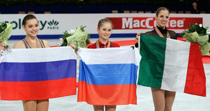SOTNIKOVA, Julia LIPNITSKAIA, KOSTNER. BUDAPEST, HUNGARY - JANUARY 17, 2014: Adelina SOTNIKOVA (L), Julia LIPNITSKAIA and Carolina KOSTNER pose at the victory Royalty Free Stock Photo