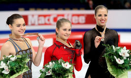 SOTNIKOVA, Julia LIPNITSKAIA, KOSTNER. BUDAPEST, HUNGARY - JANUARY 17, 2014: Adelina SOTNIKOVA (L), Julia LIPNITSKAIA and Carolina KOSTNER pose at the victory stock photography