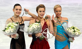 SOTNIKOVA, WAGNER, POGORILAYA. PARIS, FRANCE - NOVEMBER 16, 2013: Adelina SOTNIKOVA (L), Ashley WAGNER, Anna POGORILAYA pose during the victory ceremony at stock photography