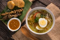 Soto ayam, chicken soup with curry. Indonesian food delicacy stock photography