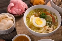Soto ayam, chicken soup with curry. Indonesian food delicacy stock image