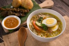 Soto ayam. shreedded chicken soup. With egg. indonesian food stock photo