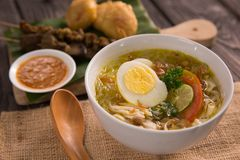 Soto ayam. shreedded chicken soup. With egg. indonesian food royalty free stock image