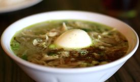 Soto Ayam. Or Indonesian Chicken Soup with boiled egg royalty free stock images