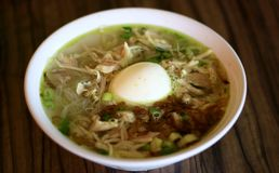 Soto Ayam. Or Indonesian Chicken Soup with boiled egg stock images