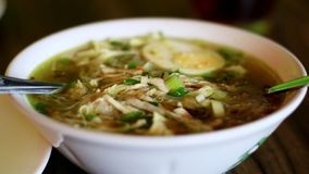 Soto Ayam. Or Indonesian Chicken Soup with boiled egg stock photo