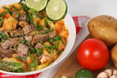 Soto betawi. Indonesian cuisine Indonesian neat soup royalty free stock images