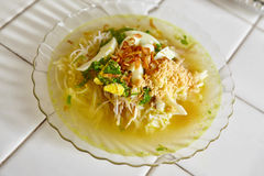 Soto Indonesian chicken soup. Soto, one of traditional Indonesia chicken soup with many herbs and spices Stock Photo