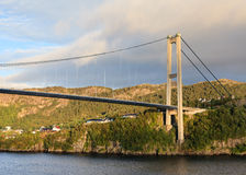 Sotra Bridge. Is a suspension bridge crossing Knarreviksundet in Norway connecting Fjell and Bergen. The city of Bergen can be seen in the background stock photography