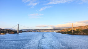 Sotra Bridge. Is a suspension bridge crossing Knarreviksundet in Norway connecting Fjell and Bergen.  The city of Bergen can be seen in the background Royalty Free Stock Photos
