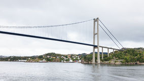 Sotra Bridge. Is a suspension bridge crossing Knarreviksundet in Norway connecting Fjell and Bergen. The city of Bergen can be seen in the background stock images